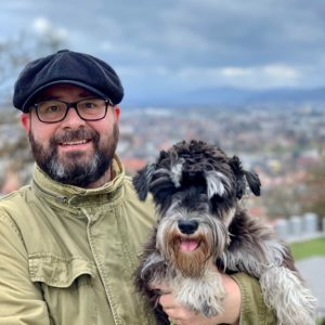 Me and Atlas, my Schnauzer, with Ljubljana in the background